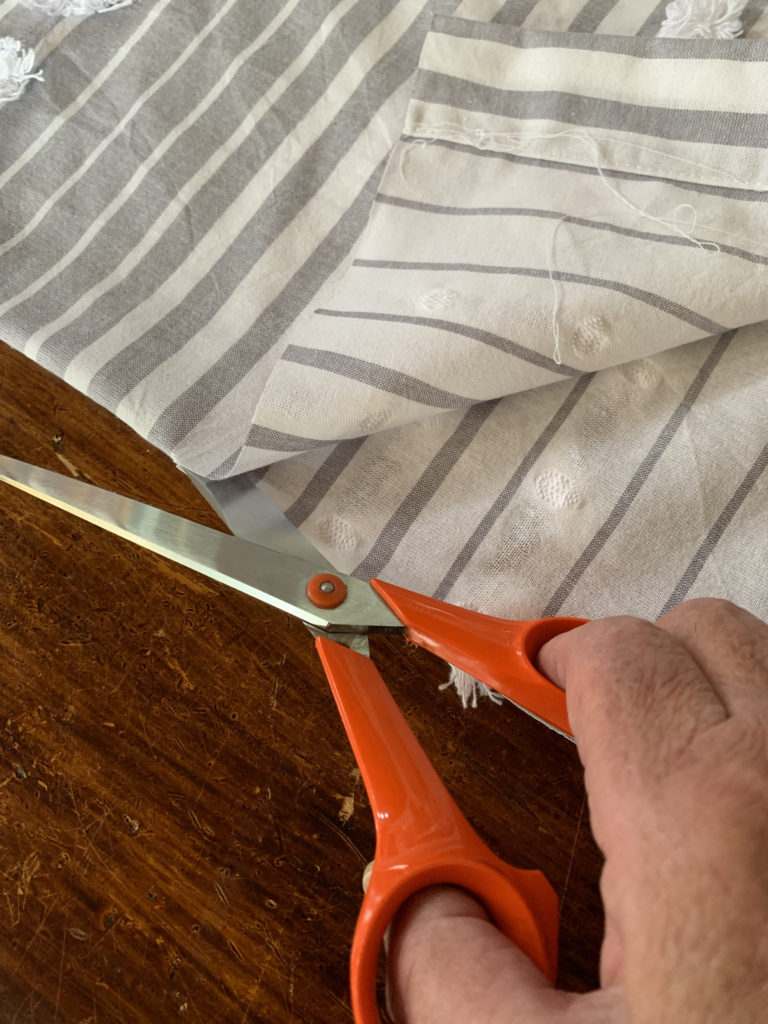 scissor cutting tablecloth for sleeves