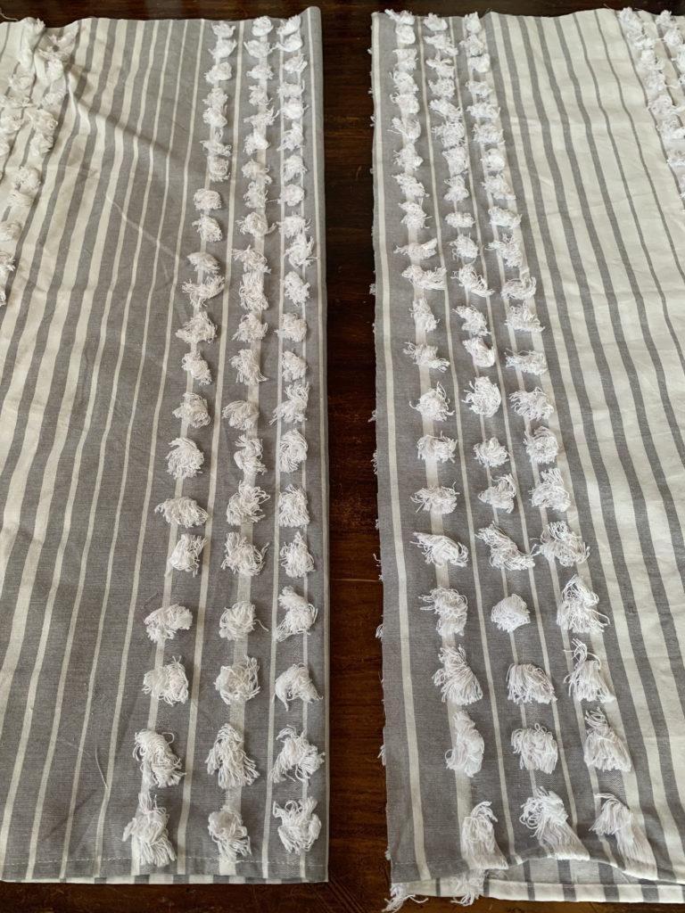 2 cut pieces of tablecloth