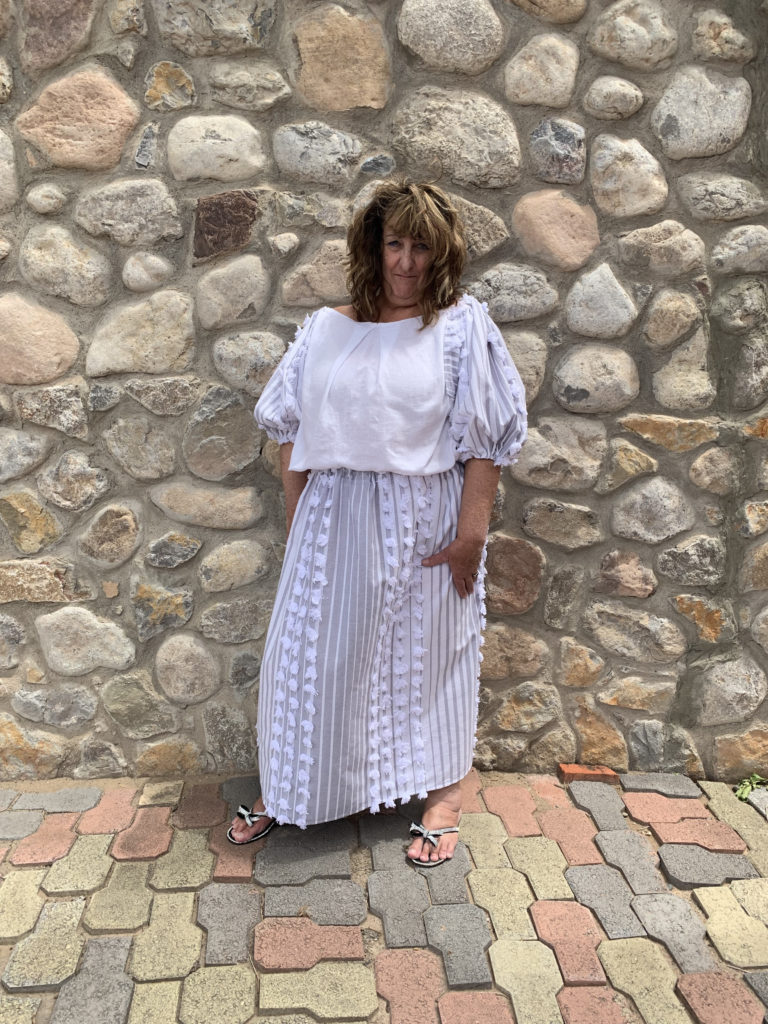 model wearing top of tablecloth and tea towels with matching tablecloth skirt