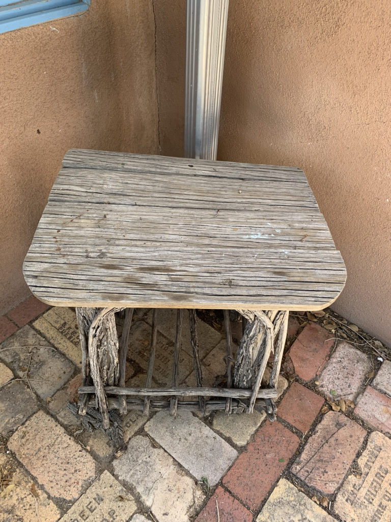 rustic outdoor wood table in corner