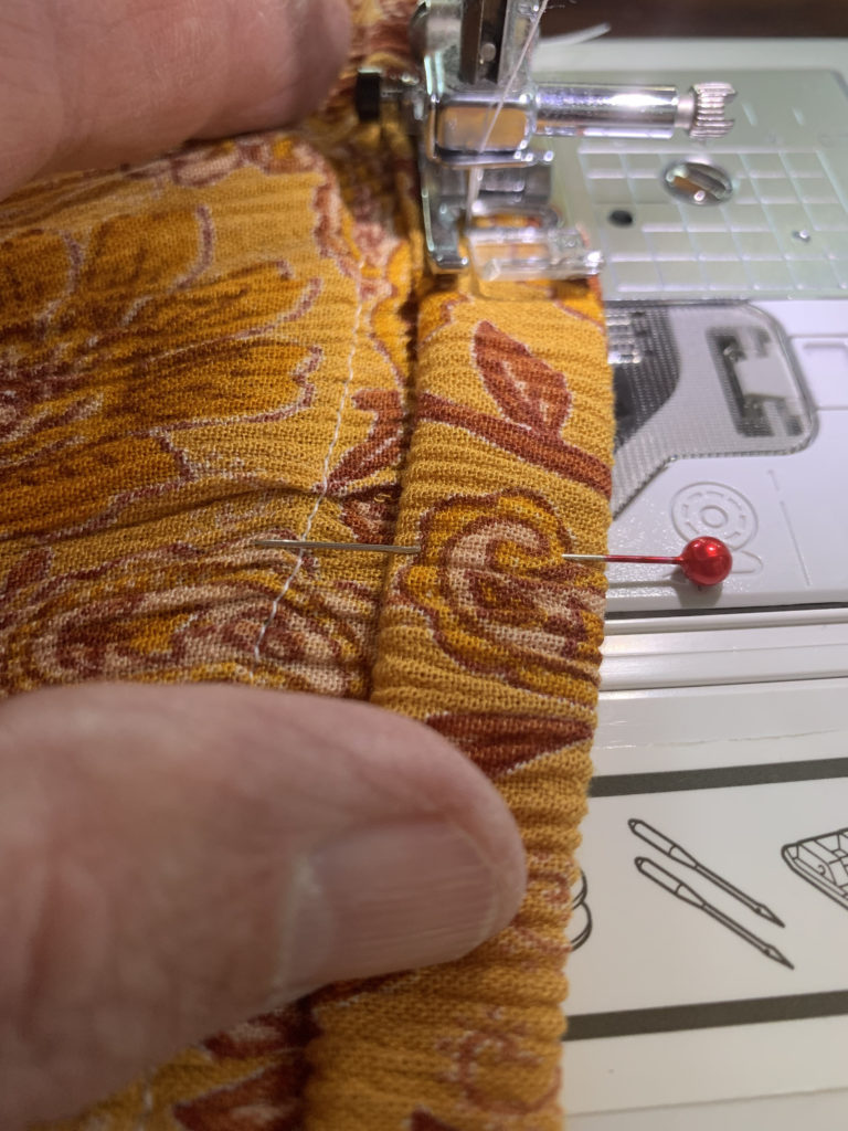 sewing machine sew hem of dress top