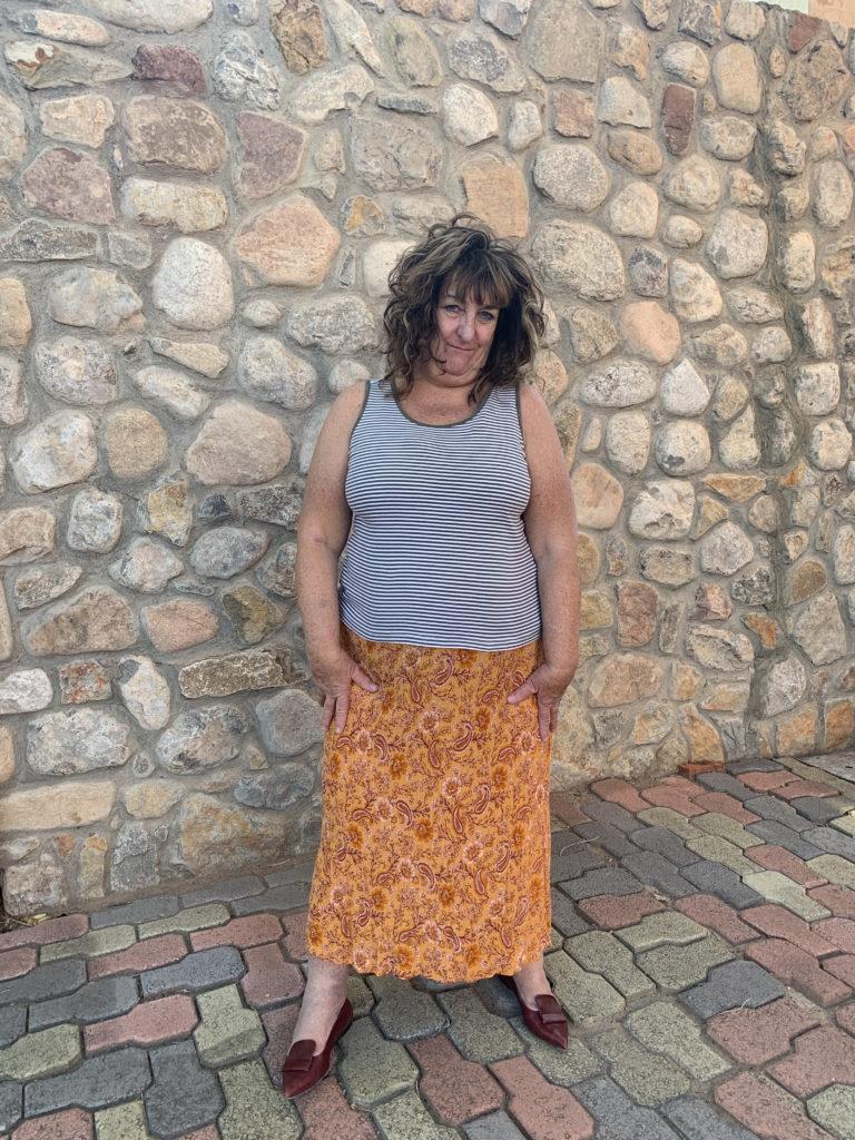 model wearing new tank tee with boho dress bottom
